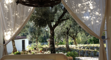The Adventure Bedroom roofed and tented on the Casa's private garden, to sleep under the stars in fine weather with 1 small double bed for one guest.